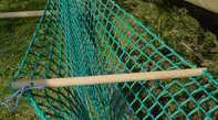 wooden pole holding haynet open for filling